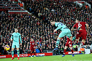 Arsenal defender Shkodran Mustafi (20) beats Liverpool defender Dejan Lovren (6) to get the header on goal during the Premier League match between Liverpool and Arsenal at Anfield, Liverpool, England on 29 December 2018.