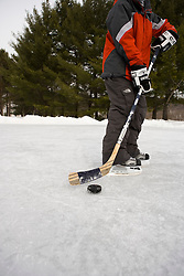 Playing hockey on a frozen pond in Quechee, Vermont. Model Release.