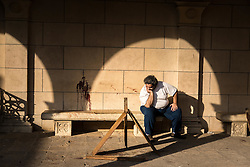 December 11, 2016 - Cairo, Egypt - A man reacts inside the campus of the Coptic Cathedral after an explosion killed over 20 people on Dcember 11, 2016 in Cairo, Egypt (Credit Image: © Sima Diab via ZUMA Wire)