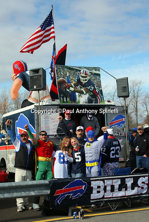 Buffalo Bills fans cheer for their team while tailgating in the parking lot before the NFL football game against the Houston Texans, November 1, 2009 in Orchard Park, New York. The Texans won the game 31-10. (©Paul Anthony Spinelli)