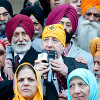 London, UK - 7 April 2013: a member of the Ealing council joins the Sikh community for the Nagar Kirtan celebrations
