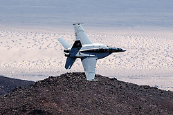 "US Navy Boeing F/A-18F Super Hornet NH-100 (SN 166873) from VFA-154 the ""Black Knights"" flies through the Jedi Transition, R-2508 complex, Star Wars Canyon / Rainbow Canyon, Death Valley National Park, California, United States of America."