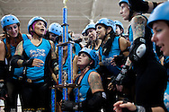 The San Diego Derby Dolls hold their championship trophy after beating Team Legit to win the Battle on the Bank III tournament, held at the San Diego County Fair, June 27, 2010.