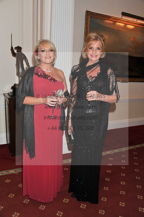 Left to right, DIANA MOORE and PENELOPE CARLIN at a dinner in aid of Caring For Courage - The Royal Scots Dragoon Guards Afghanistan Welfare Appeal held at The Royal Hospital Chelsea, London SW3 on 20th October 2011.