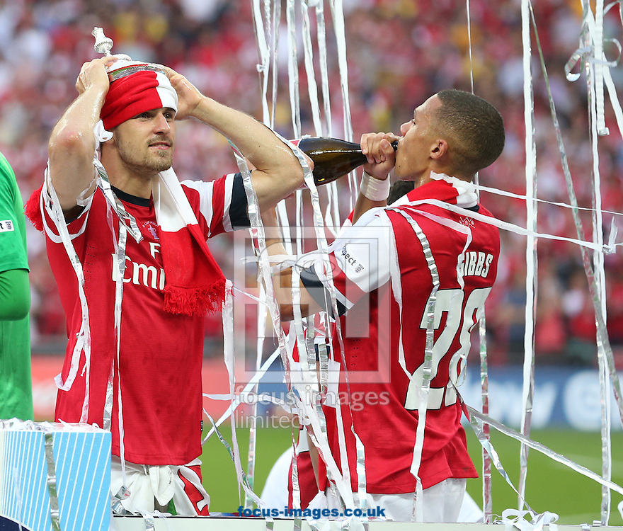 Aaron Ramsey ( L ) and Kieran Gibbs of Arsenal celebrate after the The FA Cup Final match at Wembley Stadium, London<br /> Picture by Paul Terry/Focus Images Ltd +44 7545 642257<br /> 17/05/2014