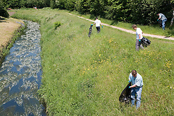 People collecting rubbish on the banks of the River Leen,