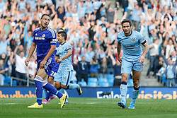 John Terry of Chelsea looks stunned and Frank Lampard of Manchester City is very restrained in his celebration after scoring against his former club Chelsea for the first time to make it 1-1 - Photo mandatory by-line: Rogan Thomson/JMP - 07966 386802 - 21/08/2014 - SPORT - FOOTBALL - Manchester, England - Etihad Stadium - Manchester City v Chelsea FC - Barclays Premier League.