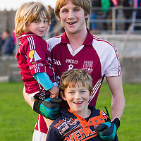 St. Brekan's Maccon Byrne with his brothers Owen and Iarla after St. Breckan's U21 B Final win