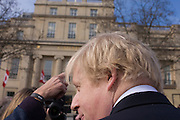 London Mayor Boris Johnson is interviewed in Trafalgar Square. As the sculpture known as Gift Horse, by German artist Hans Haacke, is unveiled in London's Trafalgar Square on the public space called the Fourth Plinth. Johnson financed the 10th artwork to appear here. The skeletal, riderless horse (derived from The Anatomy of a Horse - George Stubbs, 1766) with a London Stock Exchange tickertape is a comment on power, money and history.