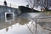 Flooding in Blake Gardens, Bridgwater, as well as the underpass under Broadway, as the Mill Leat overflows, due to the tidal surge in the River Parrett, preventing outflow from the waters running off of the Quantocks through Durleigh Brook.