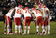 The Kansas City Chiefs offense huddles during the NFL week 12 regular season football game against the Oakland Raiders on Thursday, Nov. 20, 2014 in Oakland, Calif. The Raiders won their first game of the season 24-20. ©Paul Anthony Spinelli