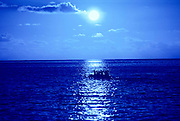 Outrigger Canoe in moonlight, Hawaii<br />
