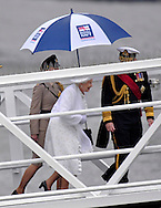 "THE QUEEN.disembarks from the ""Spirit of Chartwell"" after participating in the Thames Pageant..They were joined by Prince Charles, Camilla, Duchess of Cornwall and Prince Harry for the procession up the Thames to mark the Diamond Jubilee of Queen Elizabeth ll..The Royals braved a toprrential downpour as they watched the flotilla of 1,000 boats file past them alongside the HMS President, Katherine Docks, London_03/06/2012.Mandatory credit photo: ©DIASIMAGES..(Failure to credit will incur a surcharge of 100% of reproduction fees)..                **ALL FEES PAYABLE TO: ""NEWSPIX INTERNATIONAL""**..IMMEDIATE CONFIRMATION OF USAGE REQUIRED:.DiasImages, 31a Chinnery Hill, Bishop's Stortford, ENGLAND CM23 3PS.Tel:+441279 324672  ; Fax: +441279656877.Mobile:  07775681153.e-mail: info@newspixinternational.co.uk"