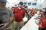 "Nick Canankamp gets a football autographed during ""Meet The Rebels"" at the Manning Center in Oxford, Miss. on Saturday, August 16, 2014. Members of the Ole Miss football, soccer, volleyball, rifle, and women's golf teams, as well as the spirit squads, greeted fans and signed autographs."
