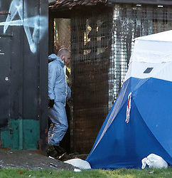 © Licensed to London News Pictures. 28/12/2017. London, UK. A Police forensics officer removes evidence from an outbuilding, at the scene in Finsbury Park where the body of a young woman was found on Boxing Day. A member of the public found the body of the woman, thought to be in her 20s, near the sports area in the centre of the park. Photo credit: Ben Cawthra/LNP