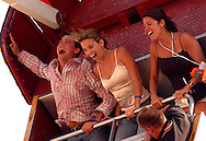 "ATLANTIC CITY, NJ - JUNE 27: From left, Rob Mariano, Amber Brkich, and Amy Newman enjoy the Sea Boy ride  during the Maxim Magazine Presents ""Fantasy Island"" at the Borgata Hotel Casino and Spa June 27, 2004 in Atlantic City, New Jersey. The event consisted of two music stages and four unique themed areas, providing a wide array of entertainment for guests; South Beach Venice Beach, Stuffland, and The Oasis. (Photo by William Thomas Cain/Getty Images)"