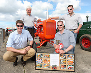 From left: Fraser McDonald, Alex McDonald, Craig McDonald and Murray McDonald with Craig's overall winning vintage tractor.