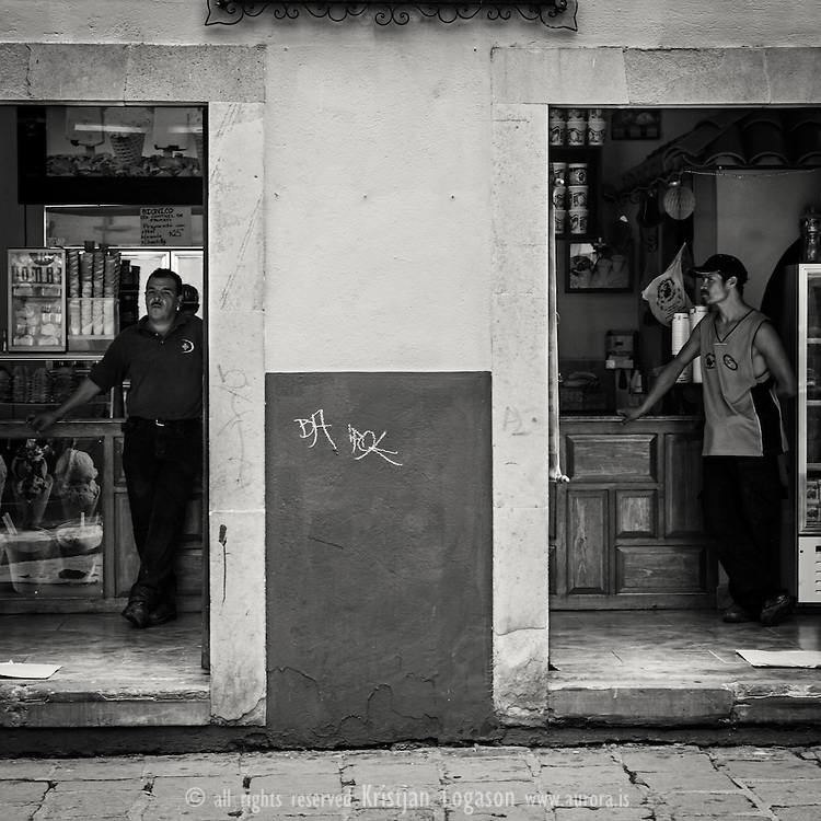 Two men standing in each end of their shop in Guanajuato