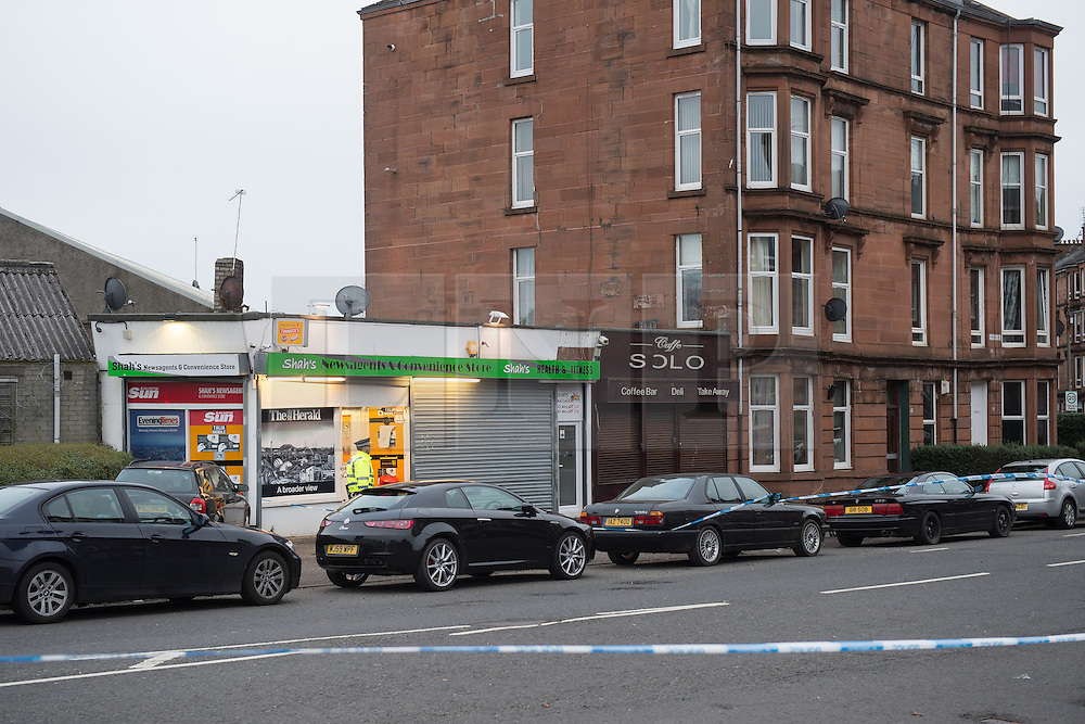 © Licensed to London News Pictures. 25/03/2016. <br /> <br /> Pictured: The crime scene - The street outside Shah's Newsagents and Connivence store, The Shawlands Glasgow.<br /> <br /> Police Scotland have arrested a 32 year old man in connection with the death of 40 year old shopkeeper Asad Shah after he was attacked outside his shop in Minard Road, The Shawlands, Glasgow on Thursday 24th March 2016.<br /> <br /> Police Scotland have announced they are treating the death as 'Religiously Prejudced'<br /> <br />  Photo credit should read Max Bryan/LNP