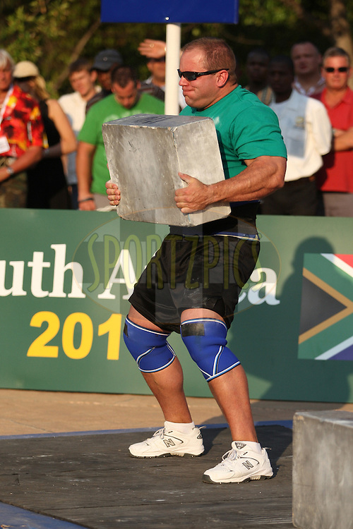 Jason Bergmann (USA) takes on the first metal block of 110kg during one of the qualifying rounds of the World's Strongest Man competition held in Sun City, South Africa.