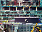 02 NOVEMBER 2018 - BANGKOK, THAILAND: The ICONSIAM development as seen from the Bangkok side of the Chao Phraya River. ICONSIAM is supposed to open November 9. The new Apple Store logo is in the middle of the frame. The logo is a blend of the traditional Apple logo and the Thai word for apple. ICONSIAM is a mixed-use development on the Thonburi side of the Chao Phraya River. It will include two large malls, with more than 520,000 square meters of retail space, an amusement park, two residential towers and a riverside park. It is the first large scale high end development on the Thonburi side of the river and will feature the first Apple Store in Thailand and the first Takashimaya department store in Thailand.    PHOTO BY JACK KURTZ