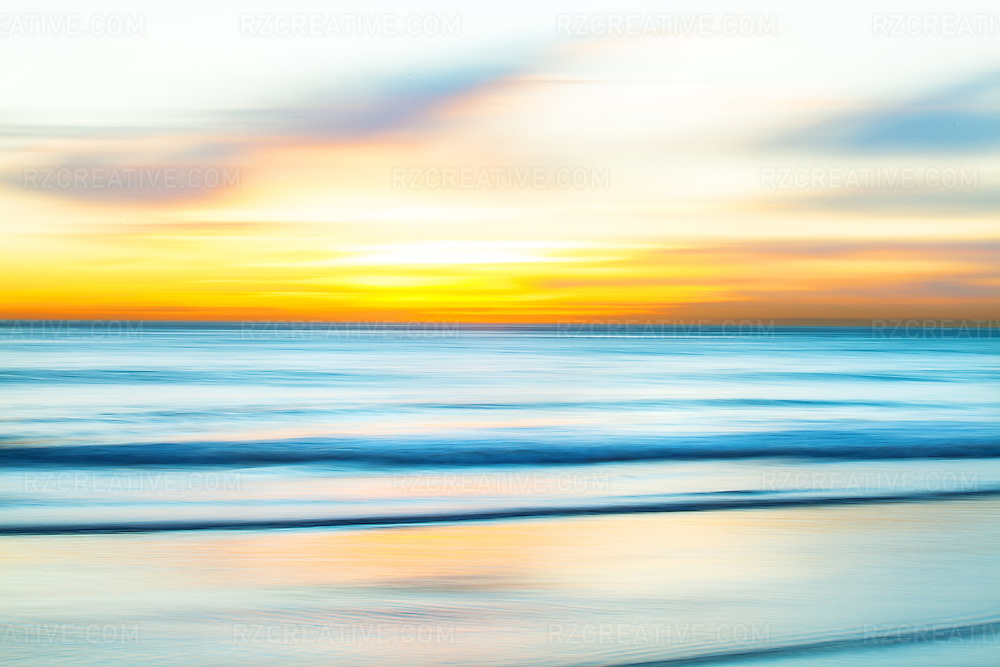 Motion blur picture of breaking waves at sunset.