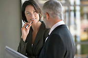 Businessman and woman talking.