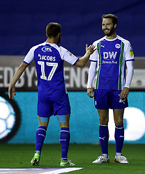 Wigan Athletic's Nick Powell (right) celebrates scoring his side's first goal of the game with Michael Jacobs (left) during the Sky Bet Championship match at the DW Stadium, Wigan.