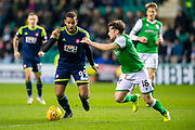 Marios Ogboe (#99) of Hamilton Academical FC runs at Lewis Stevenson (#16) of Hibernian FC during the Ladbrokes Scottish Premiership match between Hibernian FC and Hamilton Academical FC at Easter Road Stadium, Edinburgh, Scotland on 22 January 2020.