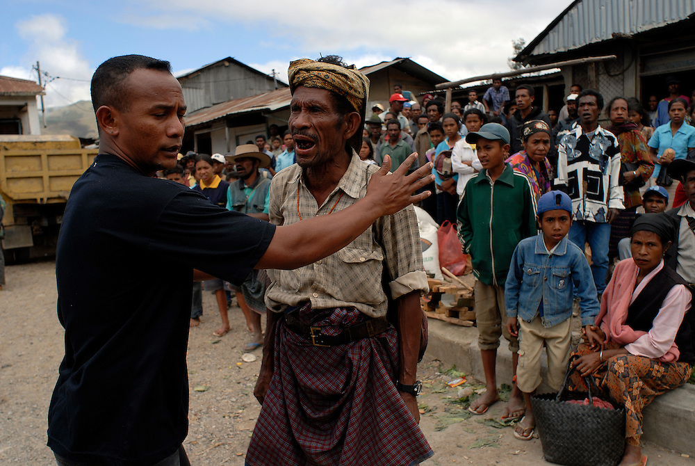 """Trouble erupts in Maubisse, East Timor,  11 June 2006. During a press conference in Maubisse by rebel leaders Major Alfredo Reinado and Manuel Tilman, gunfire is heard on the streets of Maubisse. Police fire into the there to dispurse rival gangs after a clash. A local crowd looks on in anger and frustration...During the press conference they announce they are planning a conference to seek ways of modifying East Timor's constitution to allow greater power for President Xanana Gusmao. Current Prime Minister Mari Alkitiri """"does not have the confidence of the people"""" said Tilman. """"Time is the most dangerous weapon"""" said Reinado."""