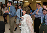 Kathy Galligan, Max Sawyer, Sam Sawyer, Mitchell Mattice and Joe Sawyer kicking up their heels on the dance floor during Gilford High School's Senior Senior dance on Wednesday evening.   (Karen Bobotas/for the Laconia Daily Sun)