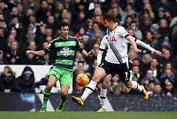 Jordi Amat of Swansea City passes the ball past Heung-Min Son of Tottenham Hotspur - Mandatory byline: Robbie Stephenson/JMP - 28/02/2016 - FOOTBALL - White Hart Lane - Tottenham, England - Tottenham Hotspur v Swansea City - Barclays Premier League