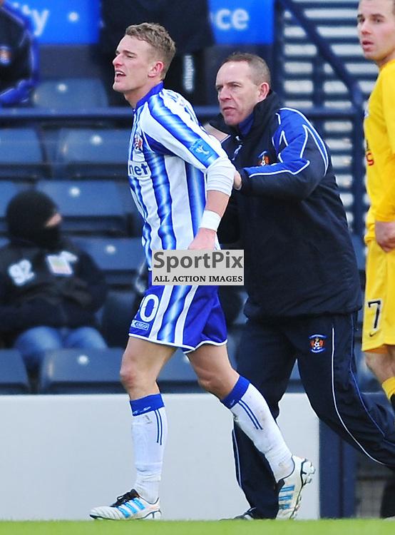Goal scorer Dean Shiels (Kilmarnock, stripes) celebrates with his dad, boss Kenny Shiels