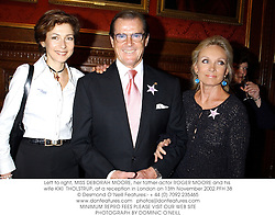Left to right, MISS DEBORAH MOORE, her father actor ROGER MOORE and his wife KIKI  THOLSTRUP, at a reception in London on 13th November 2002.			PFH 38