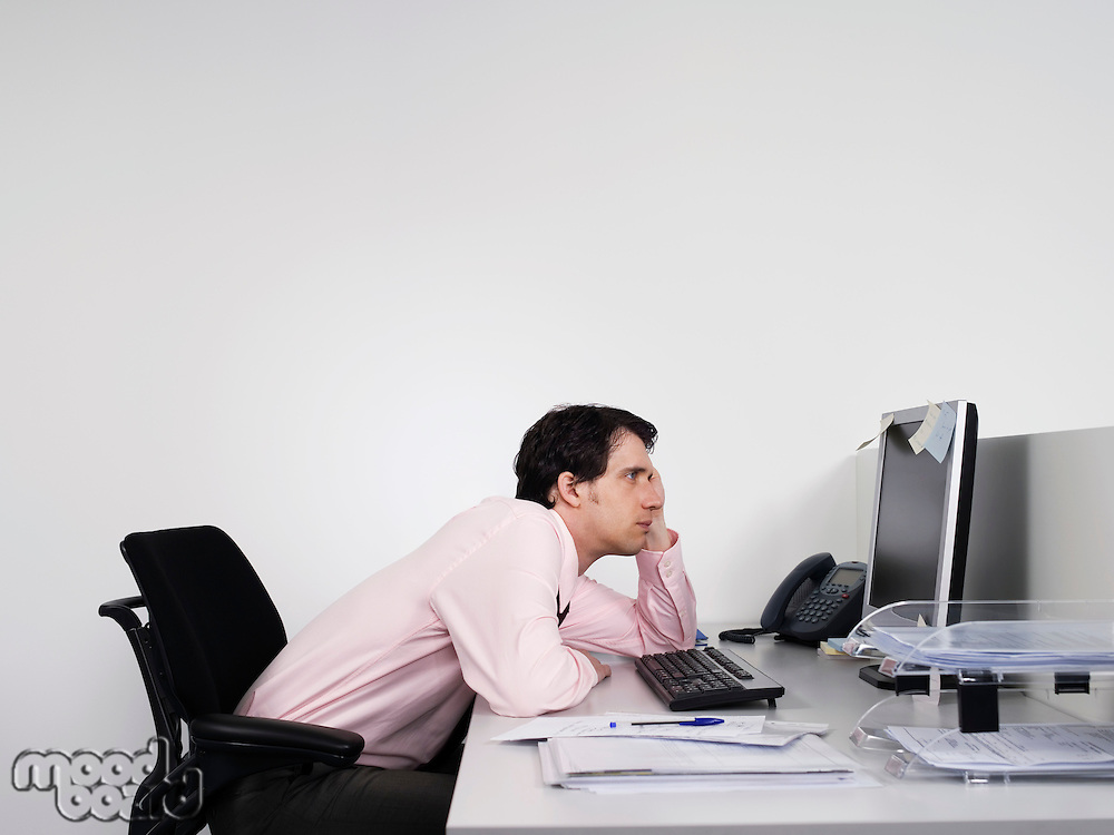 Bored office worker at desk in office