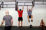 (from left) Owner Jason Hoskins of Dayton, Aaron Pertner of Dayton, Chad Banter of Centerville and Kerry Penner of Dayton during a workout of the day session at Vigor Crossfit in Moraine, Wednesday, January 25, 2012.