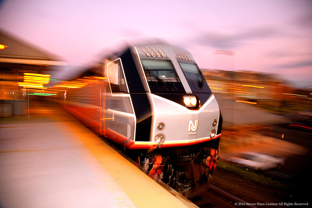 Frozen Blur of NJ Transit Train Pulling into Station at Sunset