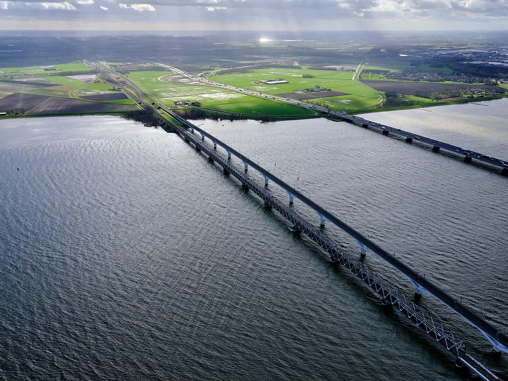 Nederland, Zuid-Holland, Hollands Diep, 25-02-2020; Hollandsch Diep, de grens tussen Brabant en Zuid-Holland met spoorbruggen: HSL-brug en de Moerdijkspoorbrug.  Rechts de brug voor het autoverkeer, A16. Aan de horizon een regenbui.<br /> Railwaybridges across Hollandsch Diep.<br /> <br /> luchtfoto (toeslag op standard tarieven);<br /> aerial photo (additional fee required)<br /> copyright © 2020 foto/photo Siebe Swart