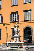 Water fountain, drinking spout and shuttered windows in Piazza del Salvatore, Lucca, Tuscany, Italy