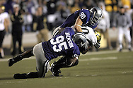 MANHATTAN, KS - OCTOBER 13:  Manhattan, KS -  Defenders Ian Campbell #98 and Rob Jackson #95 of the Kansas State Wildcats tackle running back Brian Lockridge #20 of the Colorado Buffaloes for a loss in the third quarter, during a NCAA football game on October 13, 2007 at Bill Snyder Family Stadium in Manhattan, Kansas.  Kansas State won 47-20.  (Photo by Peter Aiken/Getty Images)