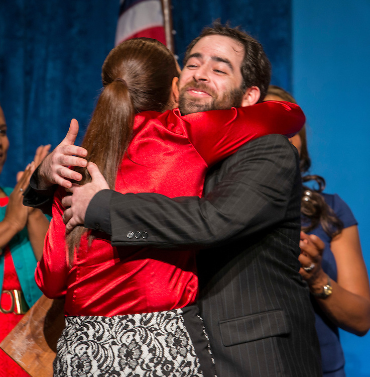Robert Uzick hugs Cunningham Elementary principal Anna White after being named Elementary Teacher of the Year during the Celebration of Excellence, May 15, 2015.