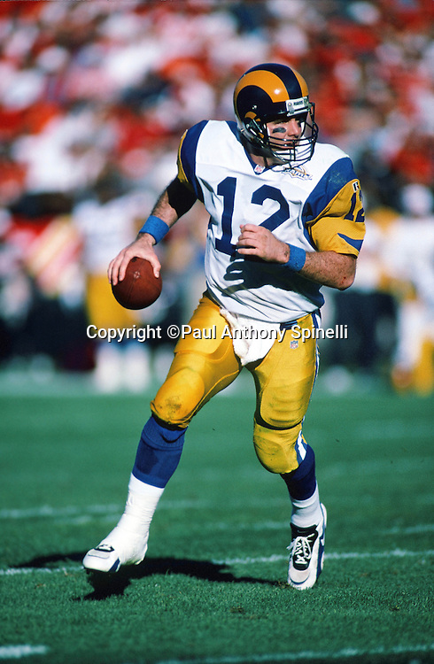 St. Louis Rams quarterback Chris Miller (12) scrambles while looking to pass during the NFL football game against the San Francisco 49ers on Nov. 26, 1995 in San Francisco. The 49ers won the game 41-13. (©Paul Anthony Spinelli)