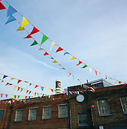 A warehouse building by the river Mersey decorated with bunting during the Liverpool Biennial, the UK's largest arts festival. The Mersey is a river in north west England which stretches for 70 miles (112 km) from Stockport, Greater Manchester, ending at Liverpool Bay, Merseyside. For centuries, it formed part of the ancient county divide between Lancashire and Cheshire.