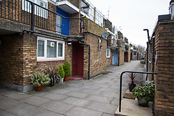 London, UK. 12th February, 2019. The Cressingham Gardens Estate, built between 1967-1979, is a high-density low-rise estate of 306 mixed housing units on the southern edge of Brockwell Park in Lambeth, of which around 200 are social rent or temporary accommodation homes. Designed by architects led by Edward Hollamby to include a children's nursery and accommodation for disabled residents, it has long been considered of architectural merit, is popular with its residents, a thriving and longstanding mixed community, and was described by Lord Esher, President of RIBA from 1965-67, as 'one of the nicest small schemes in England'. It has, however, been poorly maintained by Lambeth Council and the council now plans to demolish the entire estate and redevelop it to create 465 homes at an estimated cost of £120m. A long-running campaign to save Cressingham Gardens by 1,000 residents included a 273-page 'People's Plan' produced in consultation with technical experts which would have required no 'unnecessary demolition' and consequent dispersal of a community, providing an additional 37 genuinely affordable homes at council rent (a total of 237 social housing units alongside 100 affordable homes) for an estimated cost of £7.1m. This plan was dismissed by Lambeth Council officers within hours of submission, no ballot of residents has been permitted and a demolition funding order has since been signed by Mayor of London Sadiq Khan. <br /> <br /> Some of these photographs feature images forming part of the Sanctum Ephemeral installation by photographer Mark Aitken.