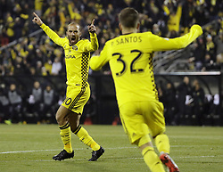 October 31, 2017 - Columbus, OH, USA - The Columbus Crew's Federico Higuain (10) celebrates a goal by teammate Ola Kamara (11) with Pedro Santos (32) during the first half of an MLS Eastern Conference Semifinal playoff game against the New York City FC in Columbus, Ohio, on Tuesday, Oct. 31, 2017. (Credit Image: © Adam Cairns/TNS via ZUMA Wire)