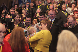 Nicola Sturgeon holds a delegate's baby following her speech to the SNP spring conference. pic copyright Terry Murden @edinburghelitemedia