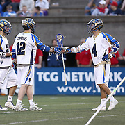 Mike Sawyer #4 of the Charlotte Hounds celebrates a goal with his teammates during the game at Harvard Stadium on May 17, 2014 in Boston, Massachuttes. (Photo by Elan Kawesch)