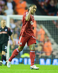 LIVERPOOL, ENGLAND - Wednesday, August 19, 2009: Liverpool's Glen Johnson celebrates scoring his side's second goal, his first goal for Liverpool, against Stoke City during the Premiership match at Anfield. (Pic by: David Rawcliffe/Propaganda)