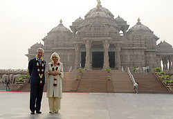 60690592  <br /> The British royal couple, Prince Charles (L) and his wife Camilla Parker Bowles, pose for photos in front of the Akshardham temple in New Delhi, India, Nov. 8, 2013. The British royal couple, Prince Charles and his wife Camilla Parker Bowles, arrived in Dehradun, northern India Wednesday to start a nine-day tour of India, reported Press Trust of India, Friday, 8th November 2013. Picture by  imago / i-Images<br /> UK ONLY