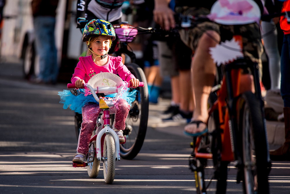 A young girl finishes her lap during the Klunker Crit as the pro's warm up for their race on Friday.The Klunker Crit attracted riders of all ages.